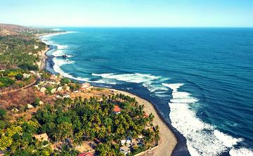 SURF+SUP+SEVA Beach Retreat